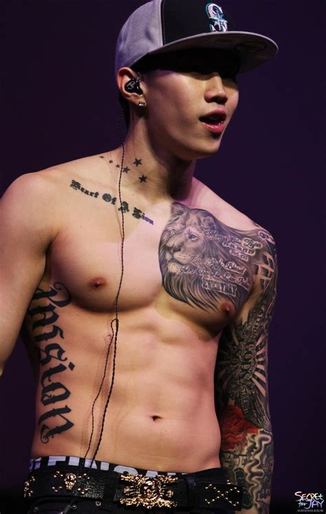 8 Male Kpop Idols with Multiple and Massive Tattoos